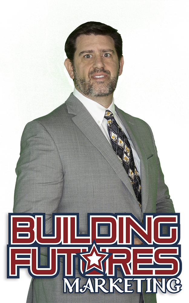 Picture of male in Grey suit and white shirt and tie with Building Futures Logo Overlay